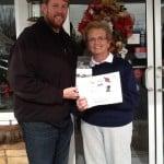 GoPro Winner, Mary Jane Beilke, pictured with Metro Garage Owner - Derrick Thompson